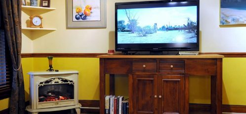 Carriage House Living Room - TV and Fireplace