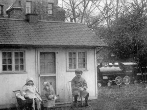 old gray photo of children outside on the grounds